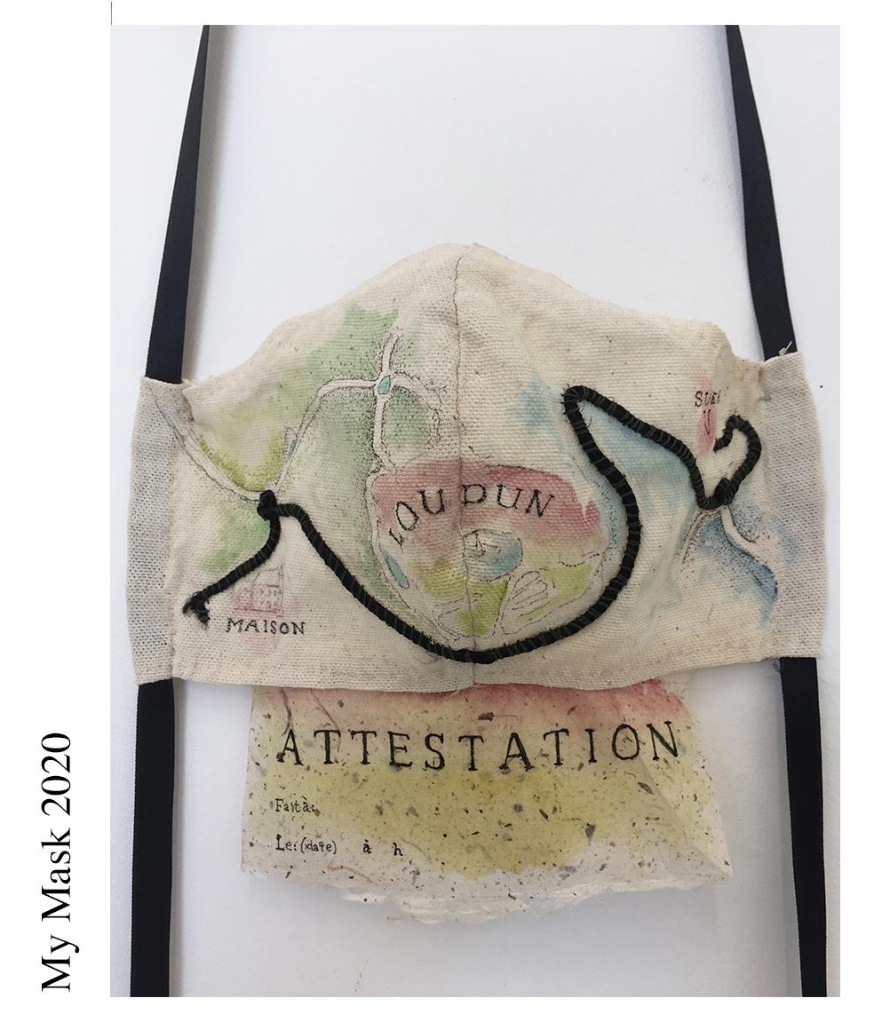 """Artist- Patricia Smith/ Title Attestation Mask  Sono in quarantena in Francia e ogni volta che usciamo dobbiamo avere un """"Attestation"""" stampata, che indichi dove stiamo andando e in quale data e ora abbiamo lasciato la nostra casa. Quindi la mia maschera è una mappa che mostra il percorso da casa al supermercato. E la certification cartacea allegata alla parte inferiore della maschera può essere compilata e sostituita con una nuova per ogni viaggio. / I am quarantined in France, and every time we go out, we must have a printed """"Attestation"""", stating where we are going and what date and time we left our house. So my mask is a map showing the route from the house to the supermarket. And the paper attestation attached to the bottom of the mask can be filled in and replaced with a new one for each trip. Materials: canvas paper ribbon thread watercolor  Date of publication 5.6.2020"""